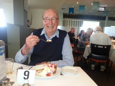 Older man eating cake
