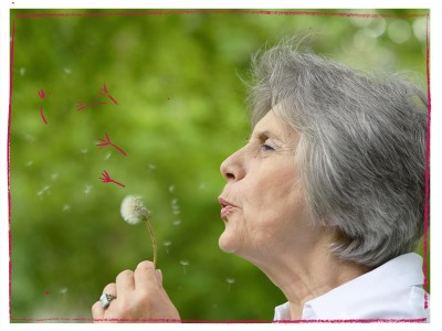 Older woman making a wish