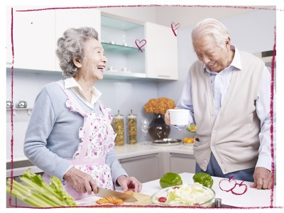Older Chinese couple cooking together in the kitchen