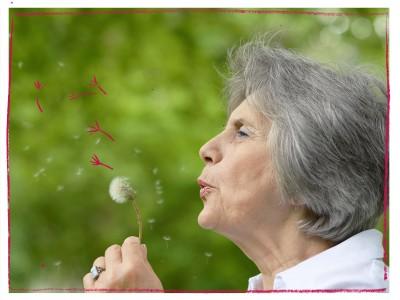 Older woman making a wish